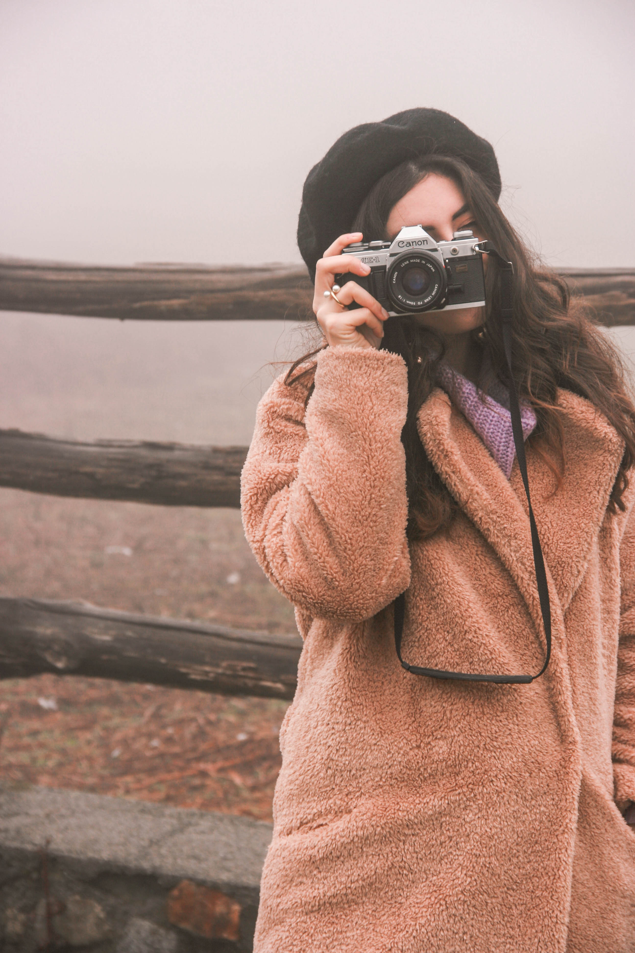 vintage camera and teddy coat